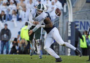Michigan State QB Brad Lewerke gets sacked by a Penn State defender