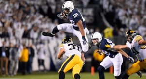 Penn State RB Saquon Barkley hurdles over an Iowa Hawkeye defender