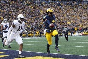 Michigan QB Shea Patterson scores a touchdown against Penn State