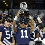 The 2019 Penn State Nittany Lion football team celebrates a victory over the Memphis Tigers in the Cotton Bowl